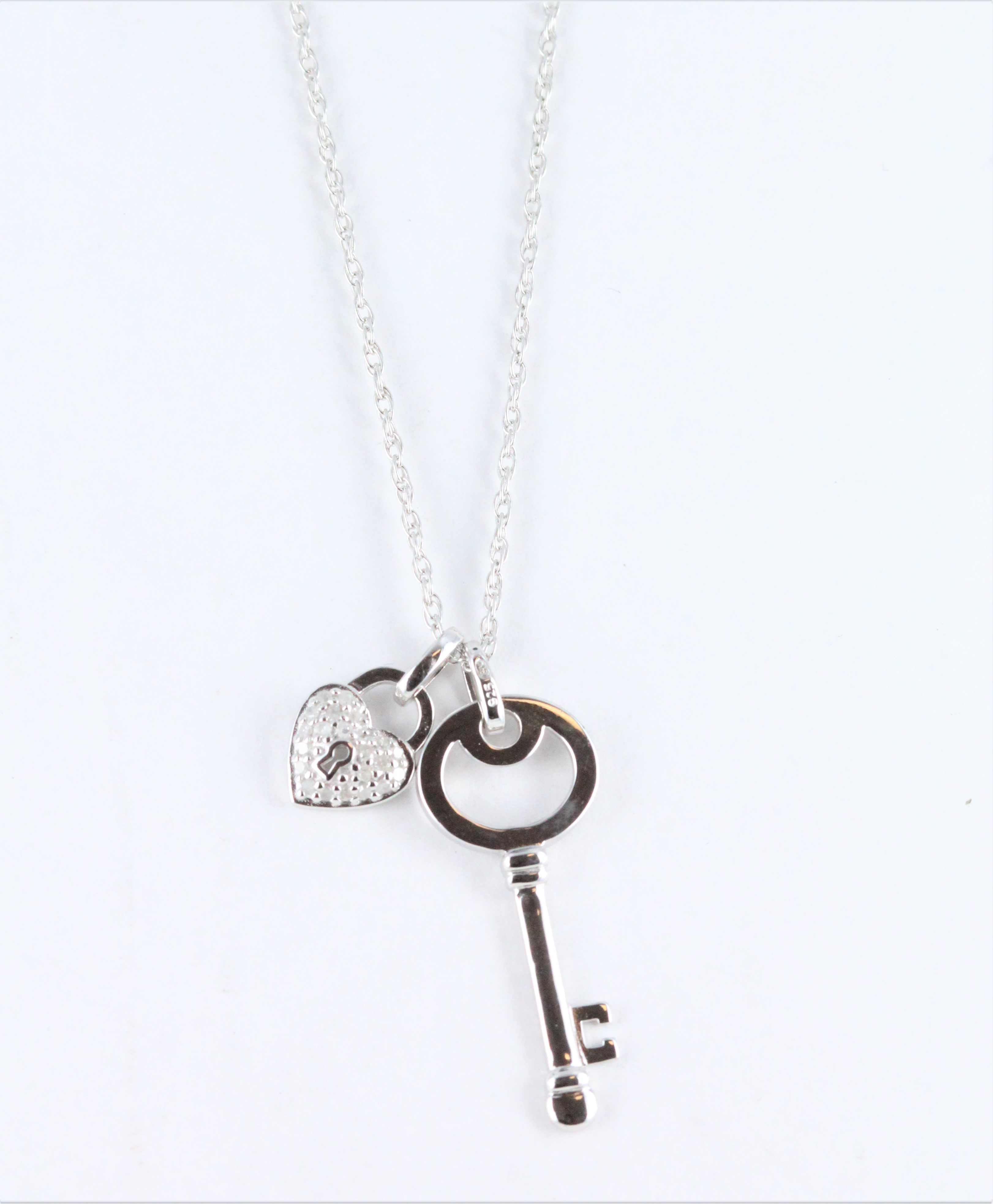 5a21bb4f5 Details about Sterling Silver Diamond Lock & Key Pendant 1/10 CTTW