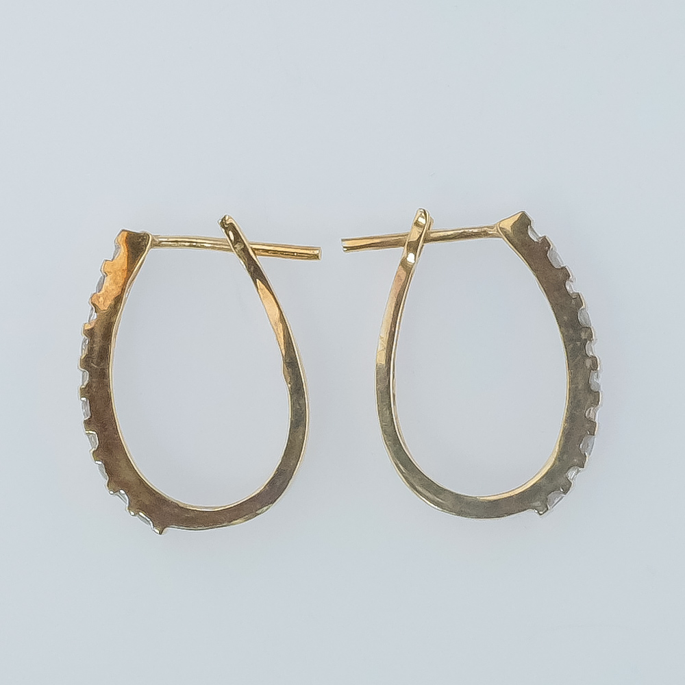 10K-Yellow-Gold-1-20ctw-Round-amp-Baguette-Diamond-Accented-Oval-Hoop-Earrings