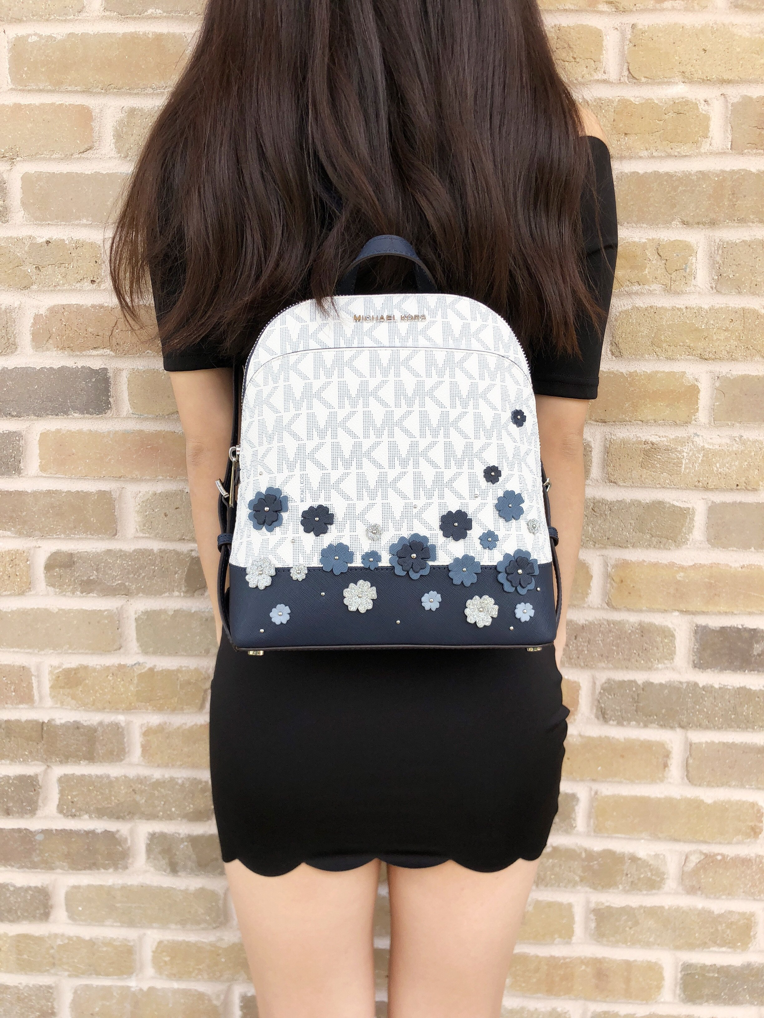 35e0e00ac4c7 new zealand michael kors emmy small backpack white mk signature navy floral  glitter 922db 5acc0