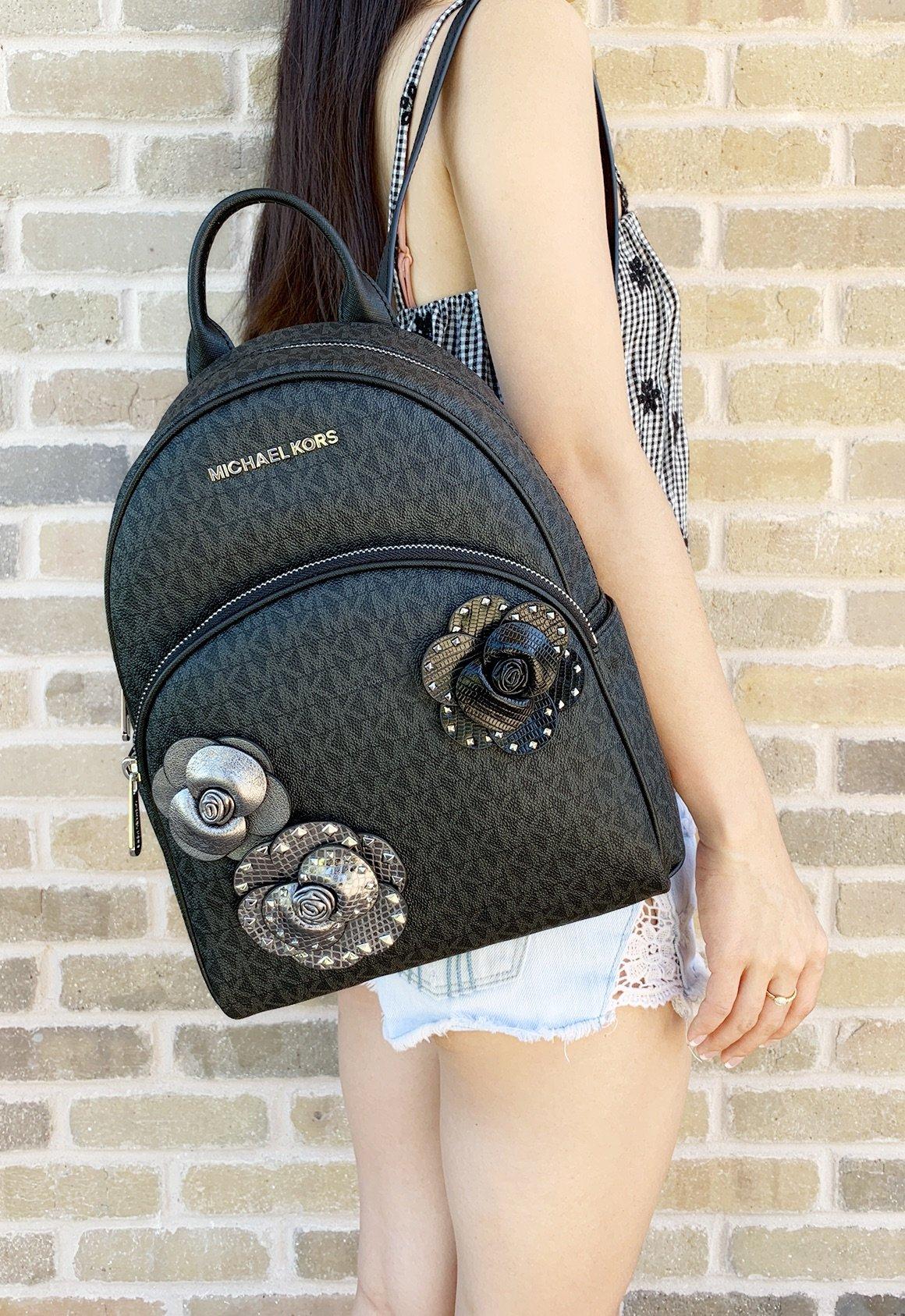 a67c5463222f Michael Kors Abbey Medium Backpack Black MK Signature Flower School ...