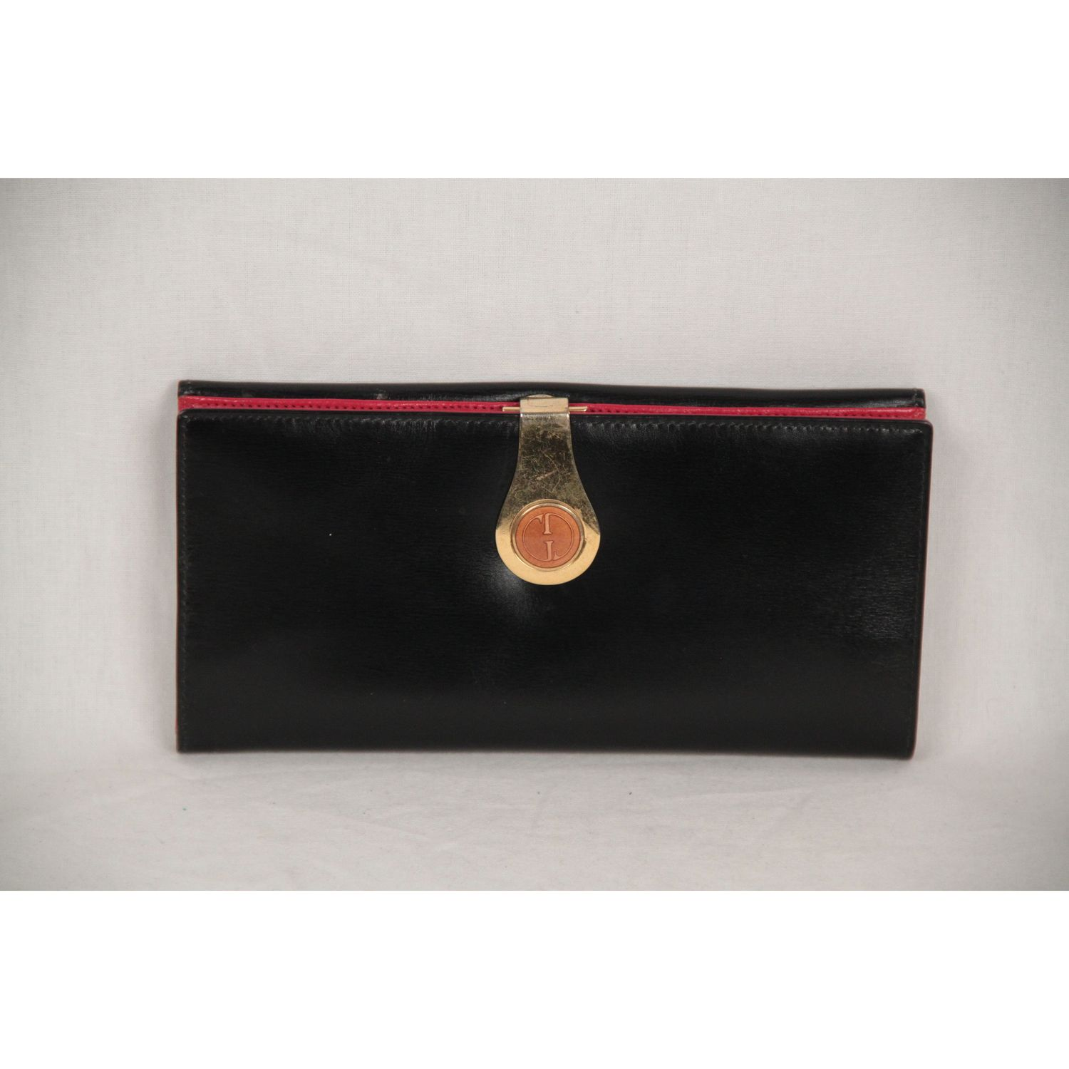 6b07727c0d16 Vintage Gucci long wallet crafted in black leather. Gold metal enameled GG  - GUCCI clasp closure. Back coin compartment with flap and snap button  closure.